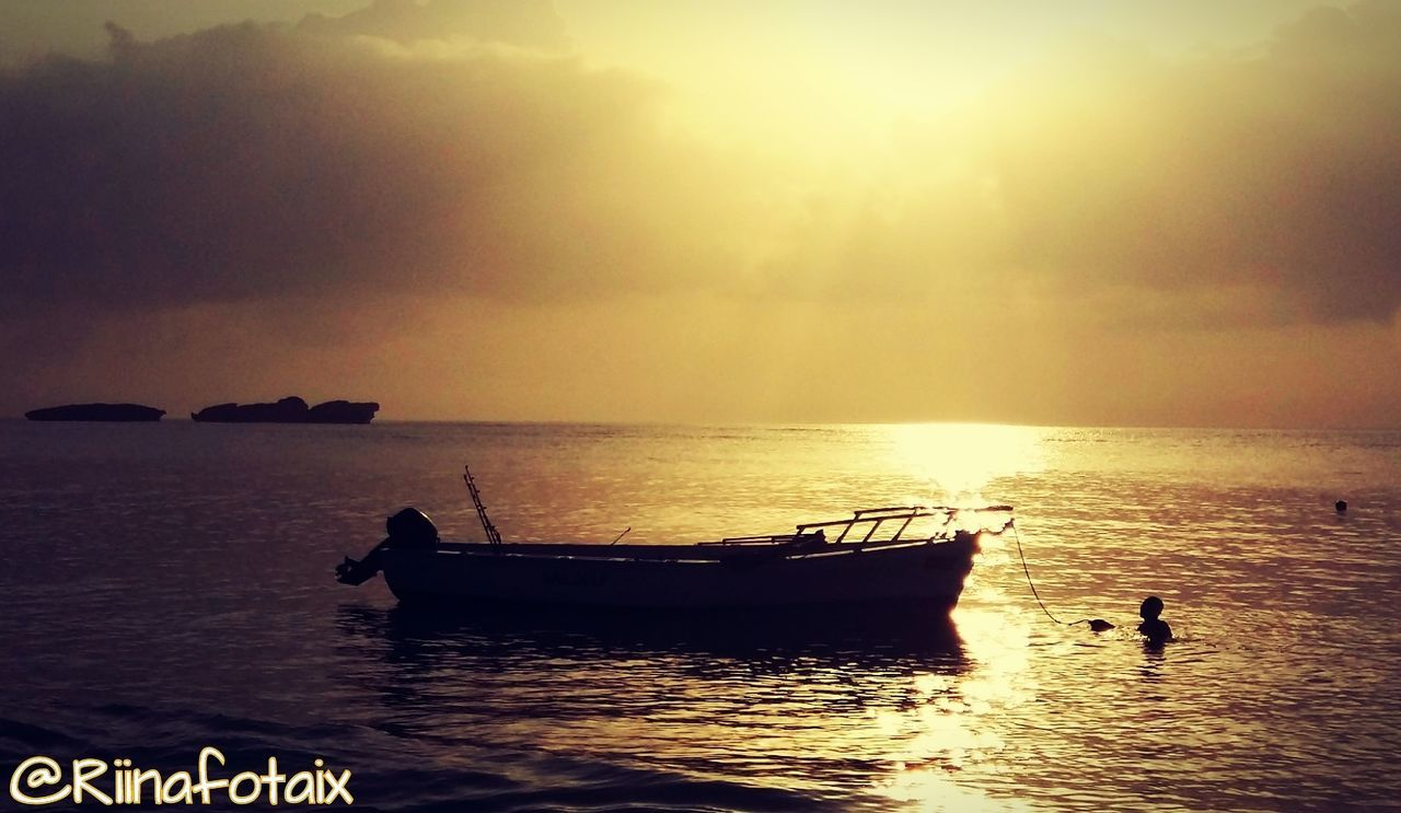 sea, sunset, water, beauty in nature, horizon over water, scenics, nature, orange color, silhouette, nautical vessel, sky, transportation, tranquility, mode of transport, tranquil scene, waterfront, outdoors, beach, longtail boat, no people, day