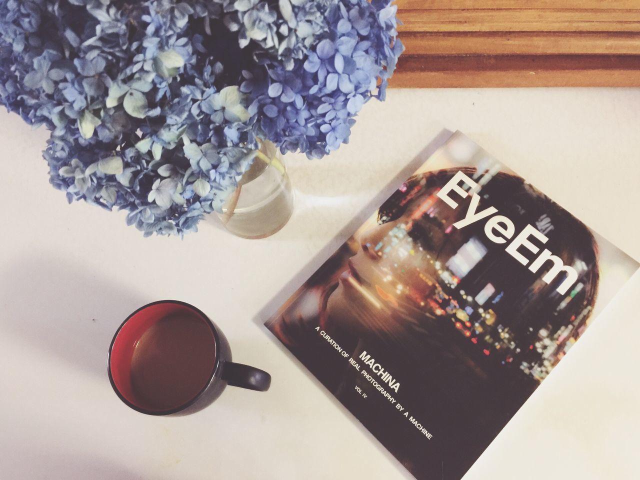 Enjoying the new EyeEm Magazine. EyeEm EyeEm Magazine EyeEm Magazine Vol IV Flower High Angle View Table Indoors  No People Freshness Close-up Nature Coffee Reading Still Life