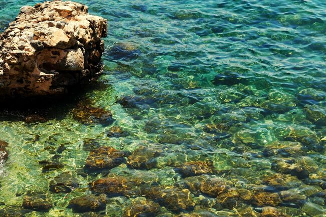 Solid As A Rock In The Waves Clear Water Water Sea High Angle View Rock - Object Tranquility Rippled Nature Tranquil Scene Shallow Blue Rock Formation Day Waterfront Damaged Outdoors Beauty In Nature Scenics Coastal Feature Shore Ocean Turkish Riviera
