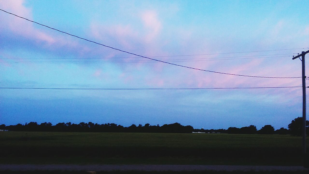 cable, sky, nature, landscape, power line, no people, low angle view, outdoors, beauty in nature, scenics, tranquil scene, tranquility, cloud - sky, tree, electricity, day, electricity pylon, telephone line