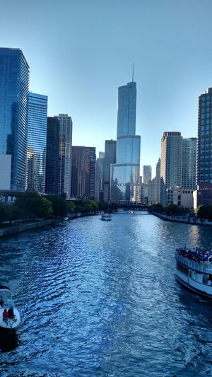 Urban Skyline City Skyscraper Blue Water Cityscape Architecture Outdoors Building Exterior Sky Modern Built Structure No People Wave Downtown District Day Cityscape Chicago Architecture Water Transportation