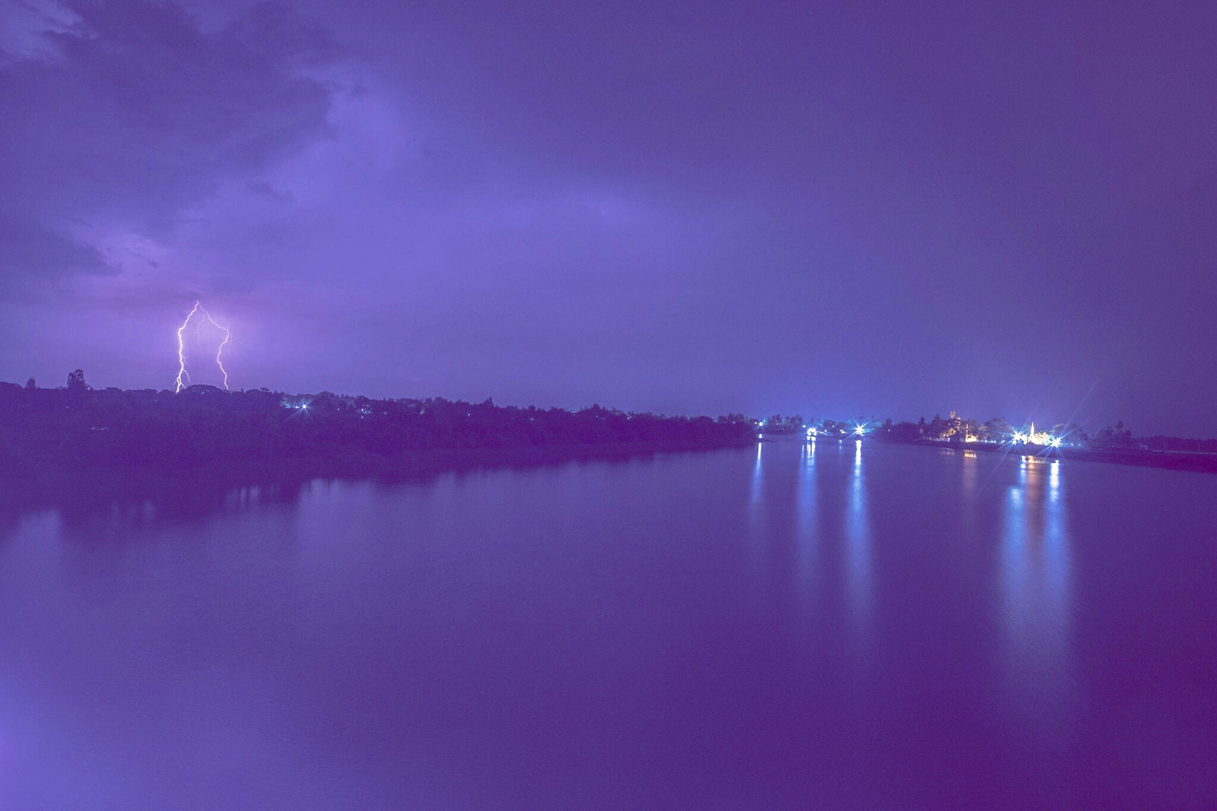 Bridge Having Running Night Reflection Water Sky Lightning No People River Nature Outdoors Cloud - Sky Thunderstorm Long Exposure Power In Nature Purple Waterfront Illuminated Forked Lightning Architecture Built Structure Beauty In Nature Scenics
