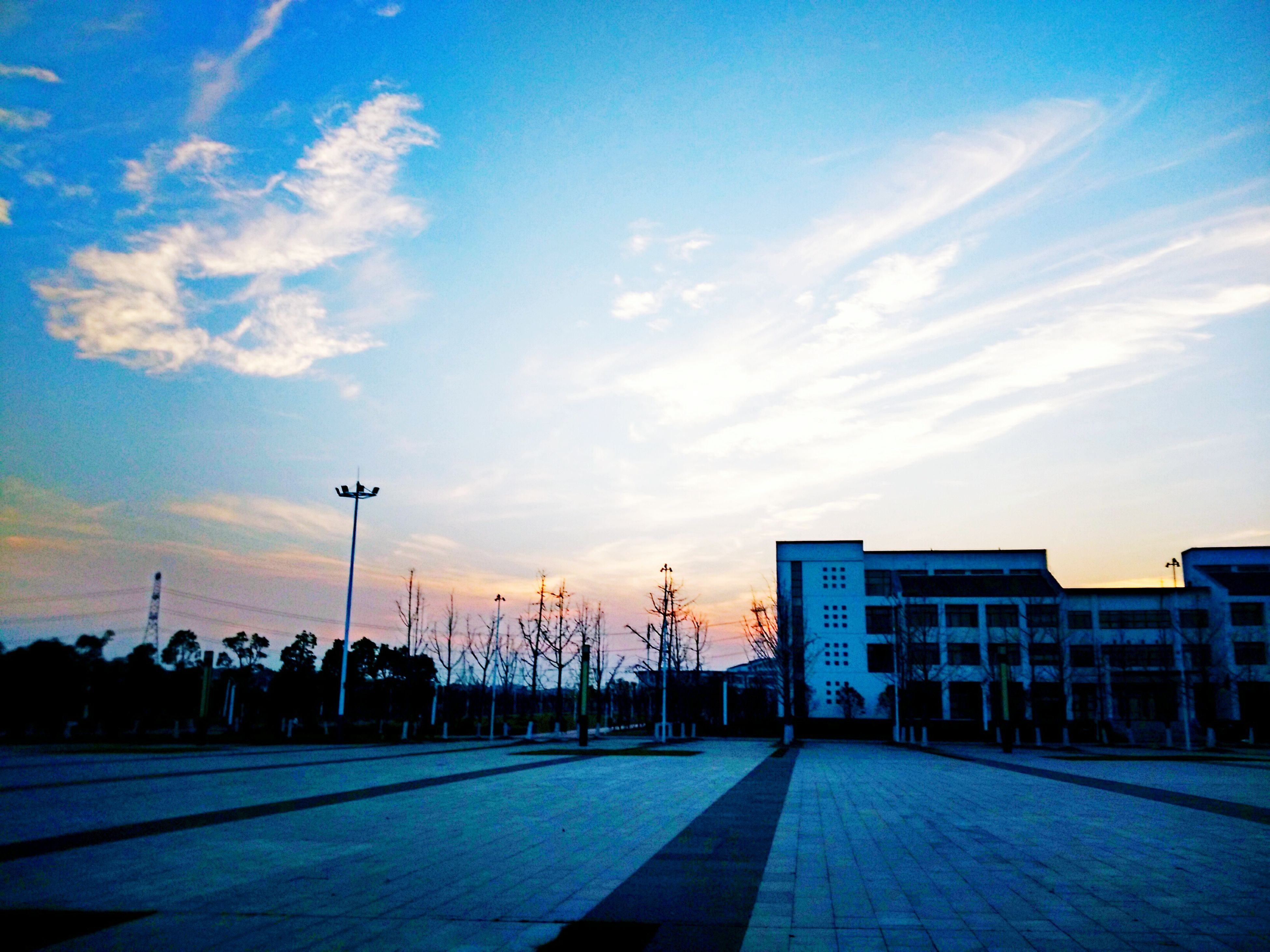 sky, cloud - sky, sunlight, outdoors, built structure, city, building exterior, architecture, no people, day