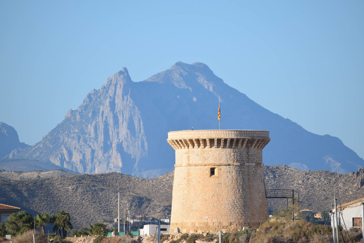 Torre el campello Architecture Beauty In Nature Blue Building Exterior Built Structure Campello Castle Clear Sky Day El Campello History Mountain Mountain Range Nature No People Outdoors Sky Torre Tourism Travel Destinations