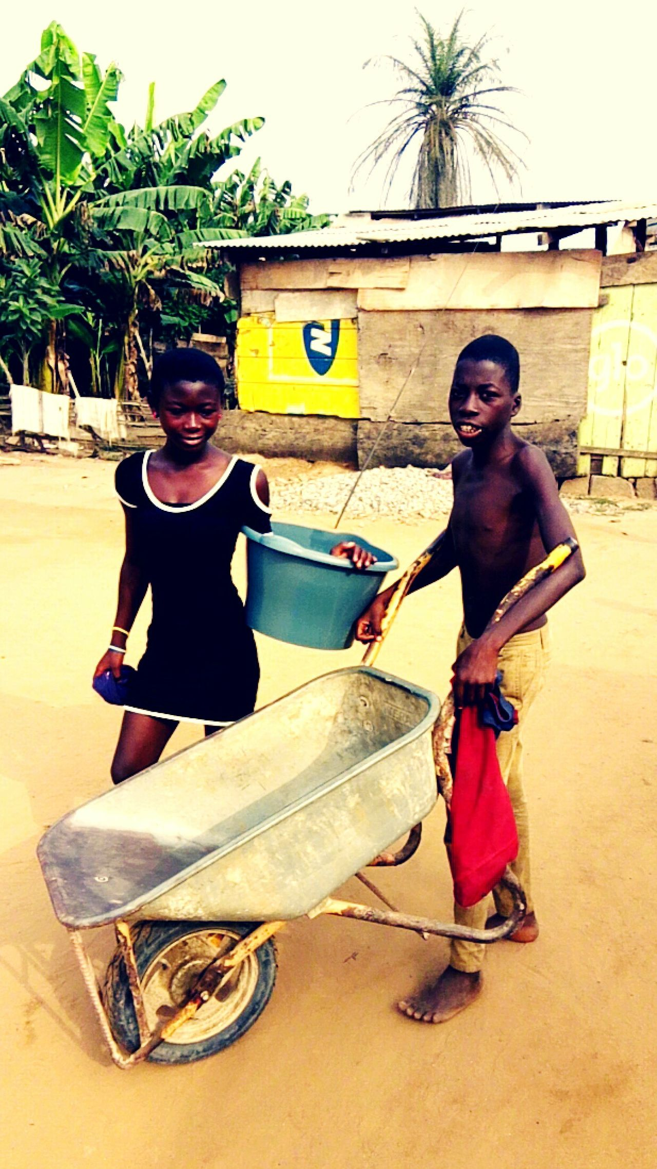 Child Labour trending in Africa GhanaFull Length Child Childhood Fun Two People Outdoors Beauty Happiness People Beach Real People Togetherness Headwear Day Adult