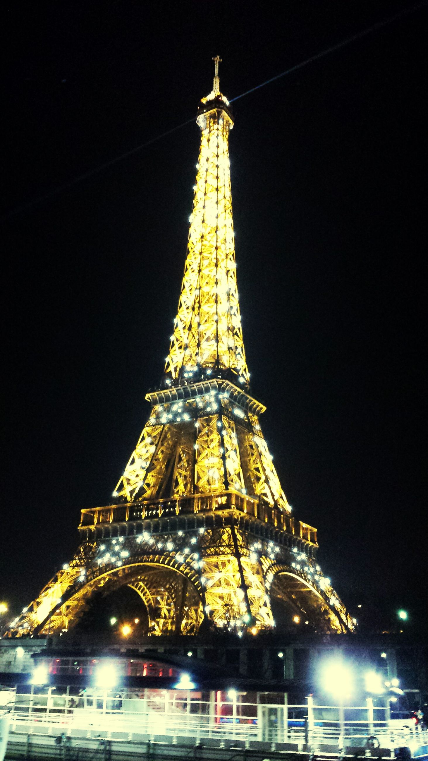 illuminated, famous place, night, travel destinations, international landmark, architecture, built structure, tourism, travel, eiffel tower, capital cities, low angle view, building exterior, tower, tall - high, city, culture, sky, history, architectural feature