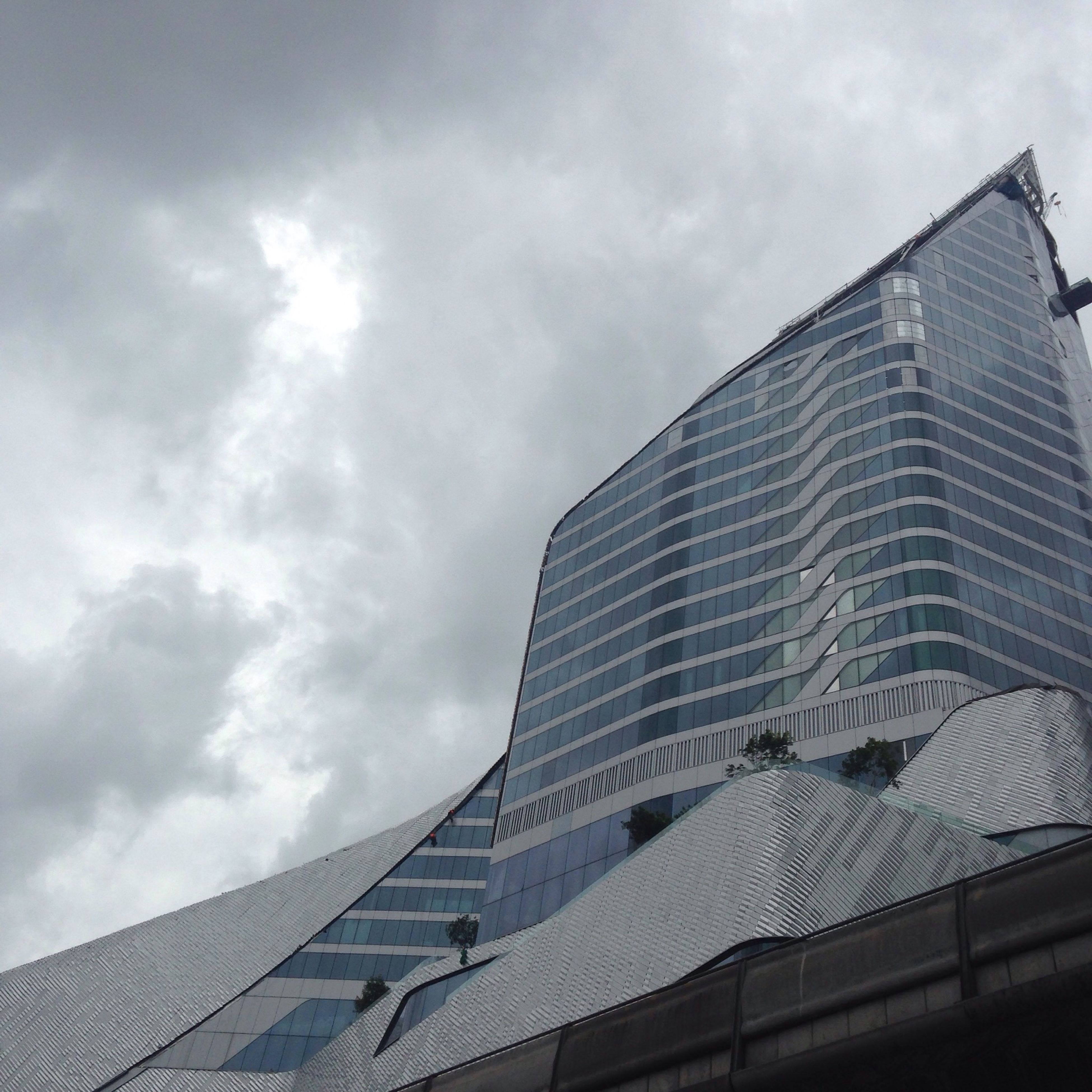 building exterior, architecture, built structure, sky, low angle view, city, cloud - sky, building, cloudy, modern, office building, cloud, skyscraper, residential building, day, roof, tower, outdoors, tall - high, residential structure