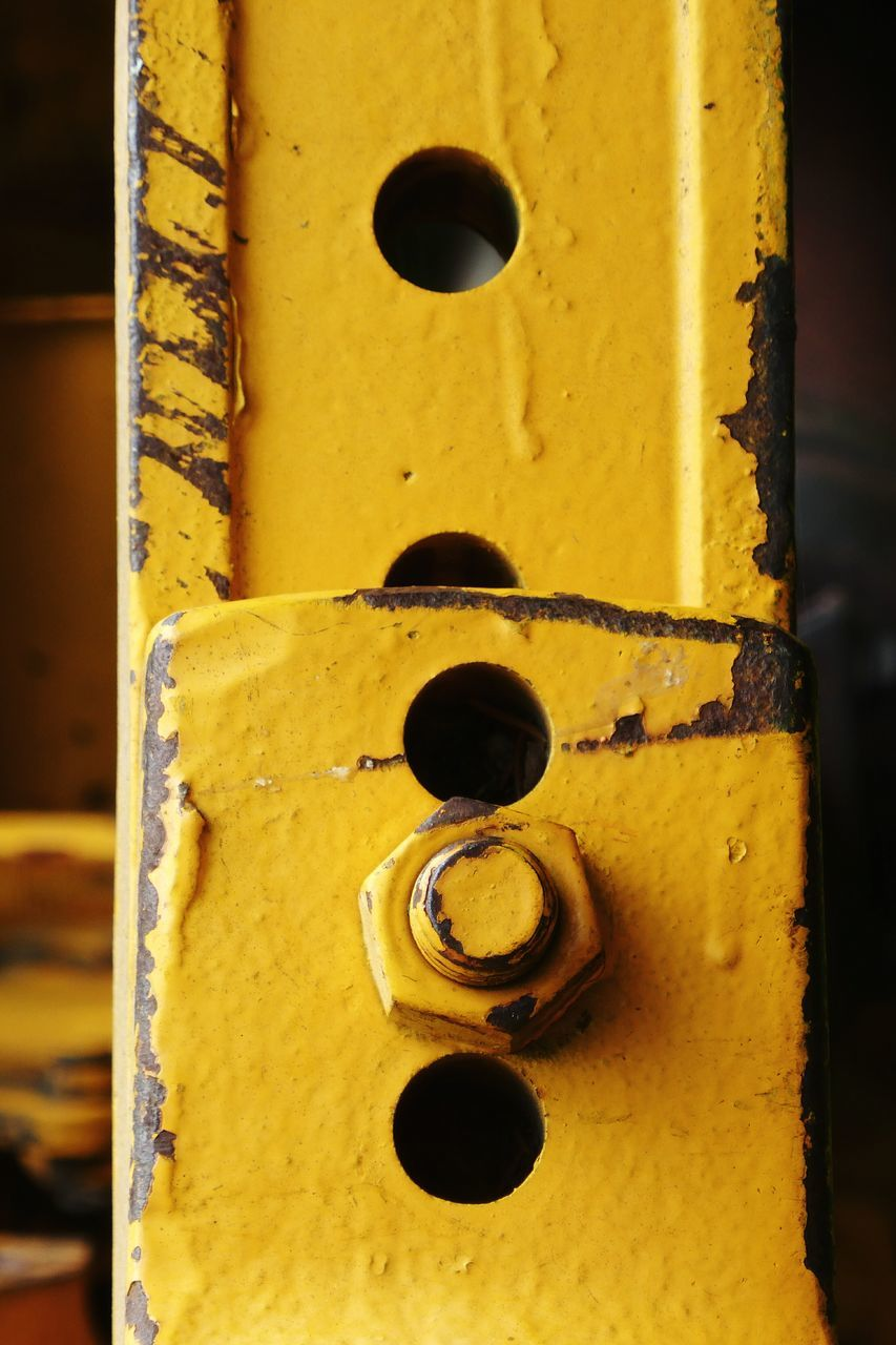 yellow, close-up, metal, door, no people, focus on foreground, day, outdoors