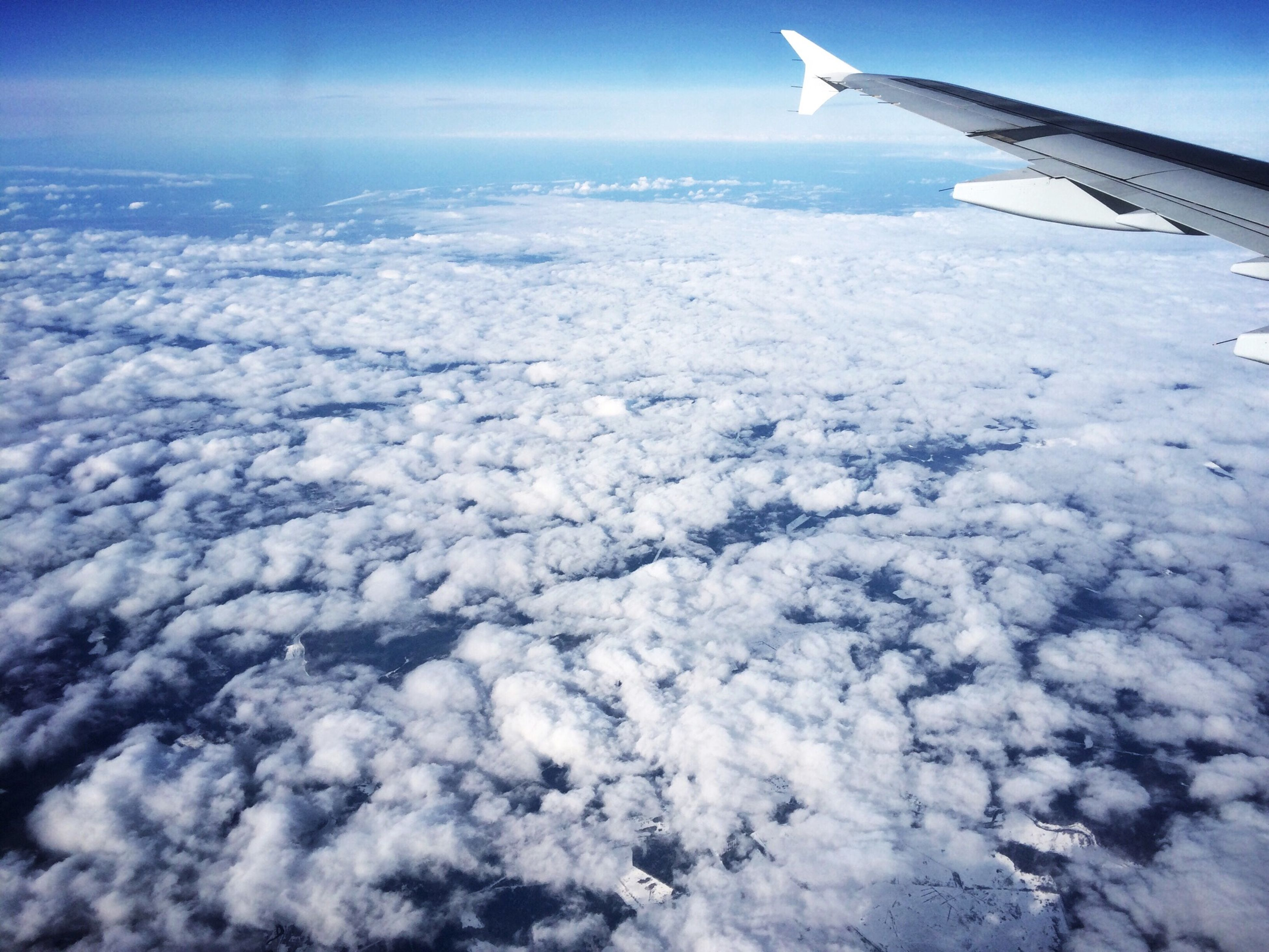 airplane, aircraft wing, snow, air vehicle, landscape, aerial view, flying, transportation, winter, sky, scenics, beauty in nature, cold temperature, nature, blue, tranquil scene, white color, part of, mode of transport, tranquility