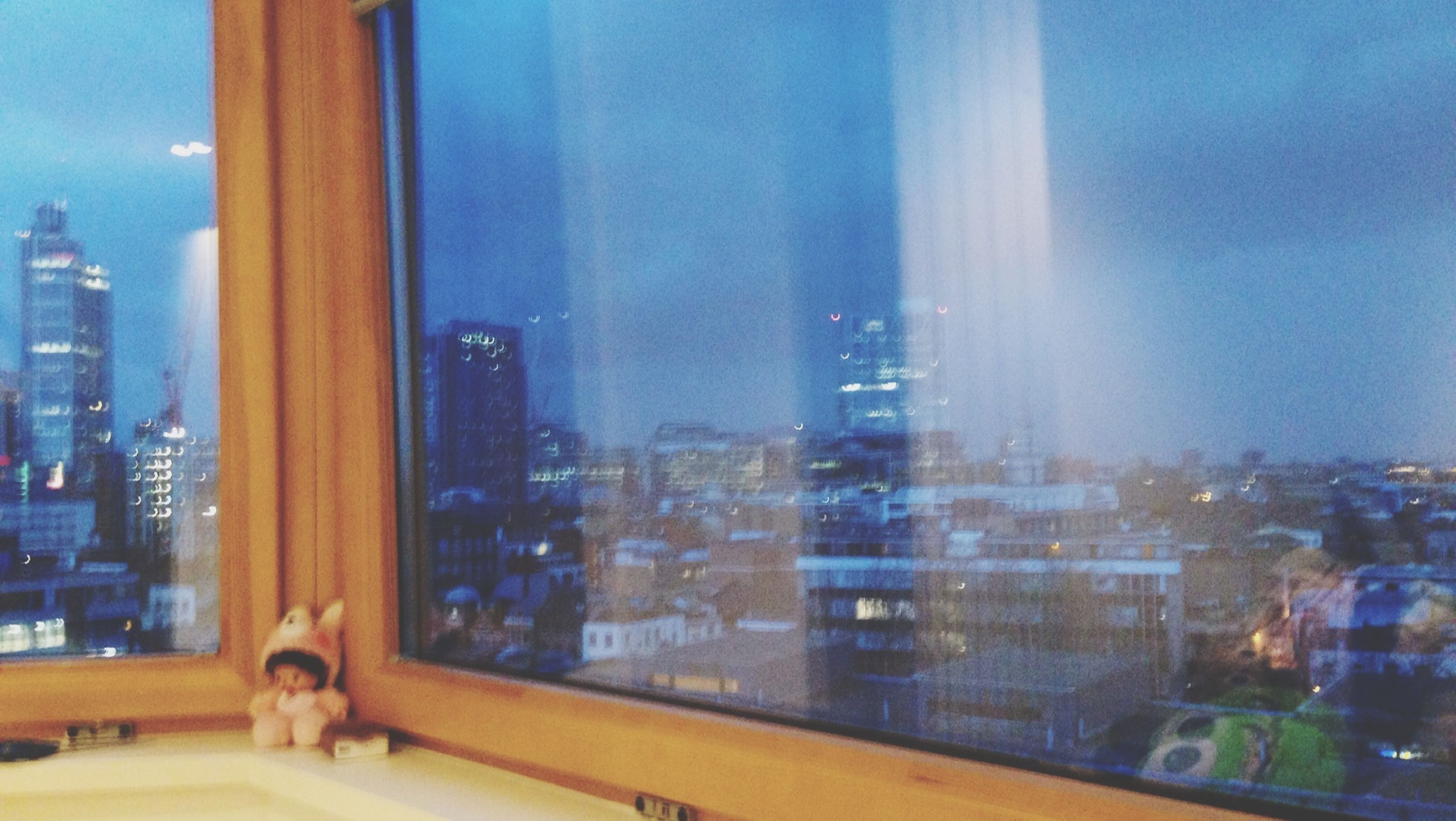 window, glass - material, architecture, building exterior, transparent, built structure, indoors, city, cityscape, glass, reflection, residential building, building, modern, office building, skyscraper, sky, residential structure, looking through window, no people