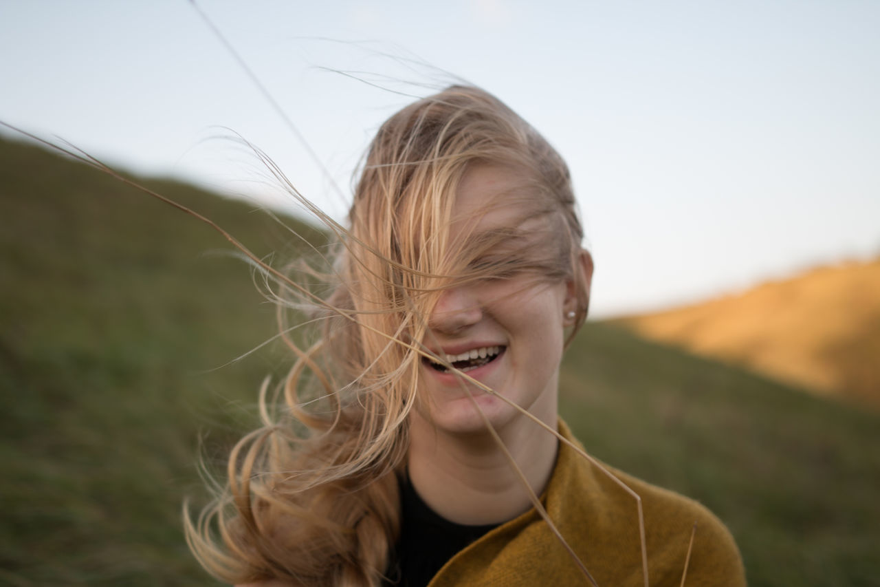 Beautiful stock photos of nature,  20-24 Years,  Blond Hair,  Carefree,  Close-Up