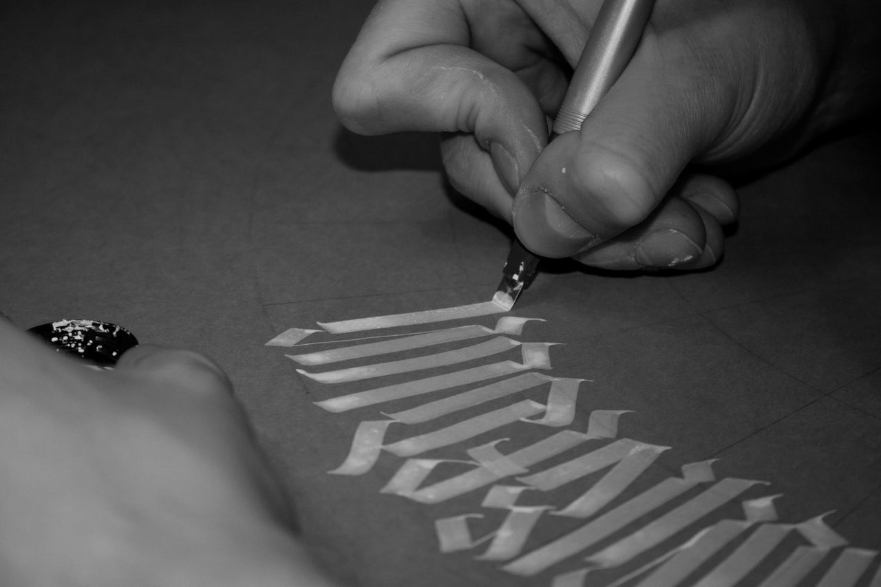 Cropped Image Of Person Writing