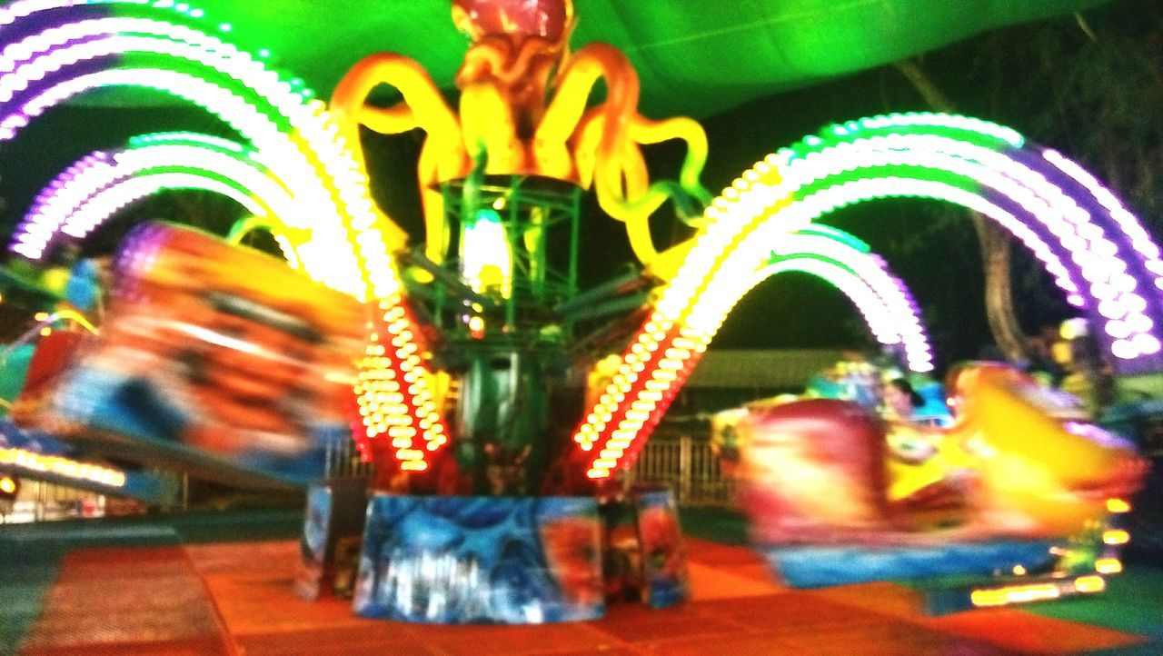 Amusement Park Arts Culture And Entertainment Multi Colored Amusement Park Ride Outdoors Sky Close-up Carousel Illuminated Night No People Fun Park Cell Phone Photography Fun Parks Day Mammal Domestic Animals Relaxation Freelance Life World Social Blurred Motion Social Network Art Telephone