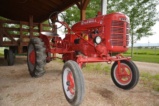 Agricultural Machinery Close-up Day Farmall Farmall Tractor Farming Land Vehicle Landscape Mode Of Transport No People Obsolete Old Outdoors Parking Red Red Tractor Rural Rural America Rural Scene Stationary Tire Tractor Tractor Wheel