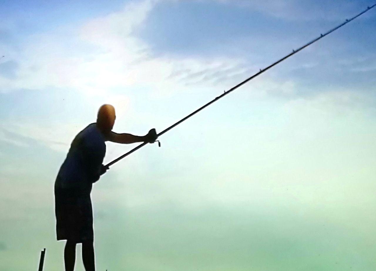Fishing Standing Casting A Fishing Line Sillouette Man Fishing. Evening Fishing Miles Away