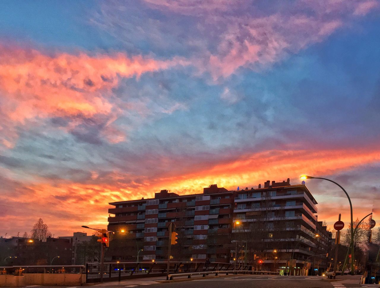 architecture, building exterior, built structure, sunset, sky, cloud - sky, city, outdoors, city life, cityscape, illuminated, residential building, no people, nature, day