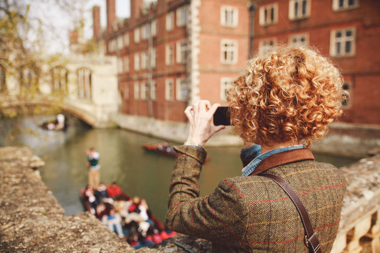 Blonde Boats Bridge Of Sighs Canal Casual Clothing City City Life Curly Hair Day Focus On Foreground Girl Leisure Activity Lifestyles Outdoors Phone Resting Smart Casual Taking Pictures Water Original Experiences Feel The Journey The Mix Up Done That. An Eye For Travel