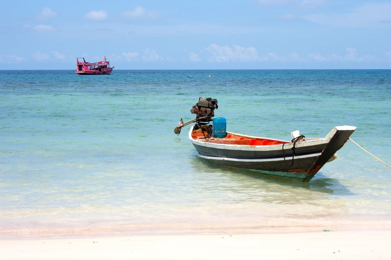 Sea Horizon Over Water Nature Beauty In Nature Sky Scenics Nautical Vessel Transportation Beach Water Tranquility Mode Of Transport Tranquil Scene Moored Outdoors Idyllic Day No People Sand Boat (null)Boats Fishing Boat Beach Life Seascape