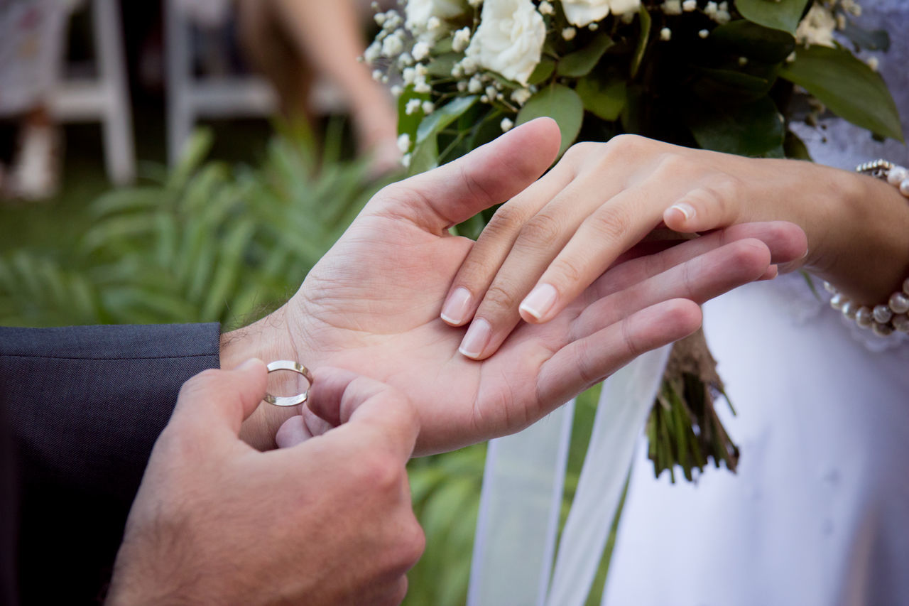 Ceremony Close-up Couple Cropped Day Flower Focus On Foreground Fragility Gold Hand Hands Holding Human Finger Leisure Activity Lifestyles Marriage  Part Of Person Ring Rings Selective Focus Touching Unrecognizable Person Wedding Wedding Photography