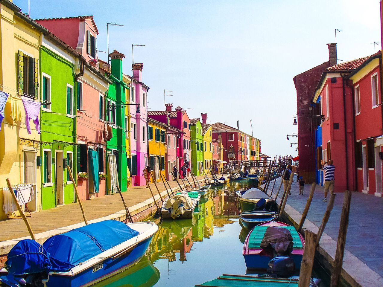 Building Exterior Architecture Island Life Multi Colored Water Reflection Canal Mode Of Transport Sky Transportation Cultures No People Outdoors Nautical Vessel Day Gondola - Traditional Boat Rows Of Things House Paint Exterior Design Row Of Houses Colorful Houses Home Exterior Burano Simple Life Boats And Moorings