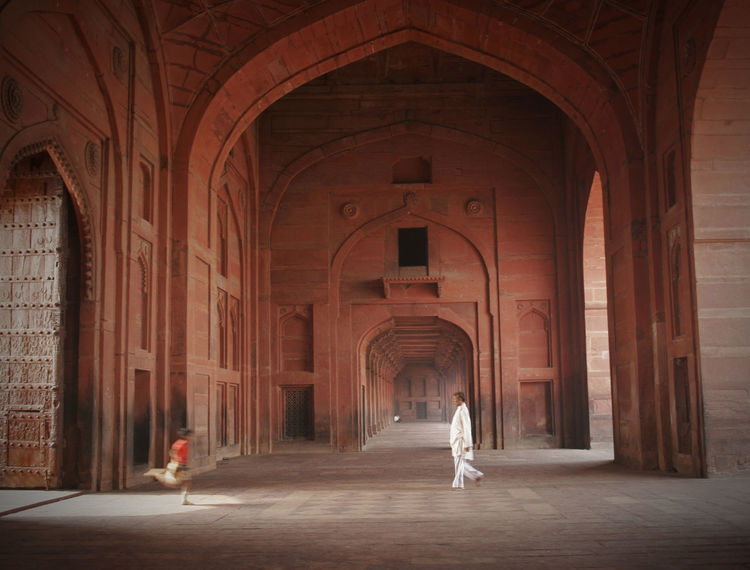 Telling Stories Differently Agra Fort Arch Architecture Archway Boy Running Ceiling Childhood Column Corridor Entering Entrance Historic India Indoors  Interior Life Light Motion Old Old Buildings Showcase: February Symmetry Terracotta Tunnel