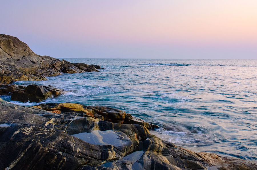 Beach Coastline Geology Horizon Over Water Ocean Outdoors Physical Geography Rippled Rock Rock Formation Rough Sea Seascape Shore Surf Vacation Voyage Water Waterfront Wave