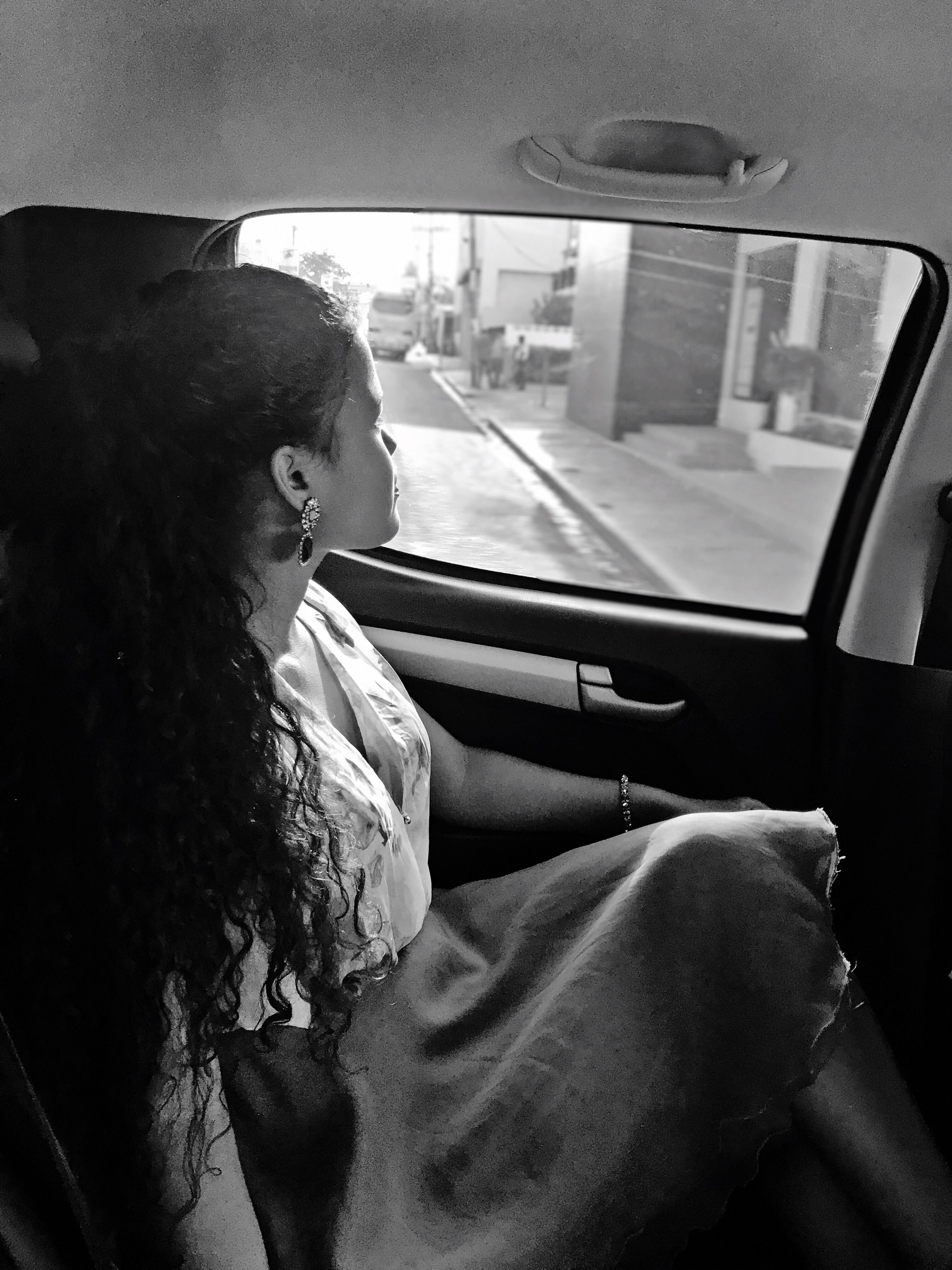 vehicle interior, car interior, transportation, car, mode of transport, land vehicle, one person, real people, journey, sitting, day, vehicle seat, young adult, young women, close-up, outdoors, people