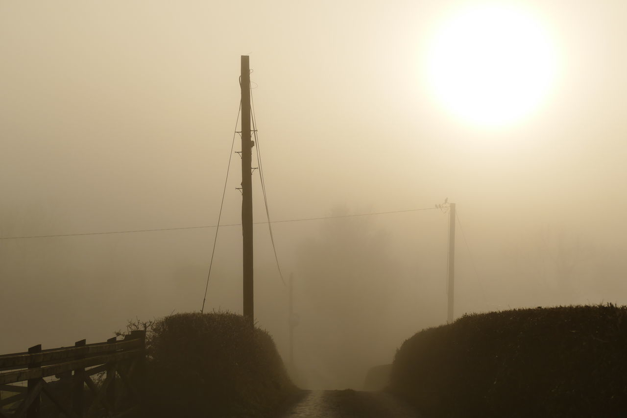 Foggy day.. Beauty In Nature Connection Day Dream States Electricity  Electricity Pylon Ethereal Fog Foggy Foggy Weather Nature No People Outdoors Renewable Energy Silhouette Silhouette_collection Sky Softness Sun Sunset