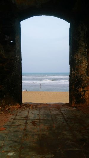 View Of Bay Of Bengal Behind From A Door Frame