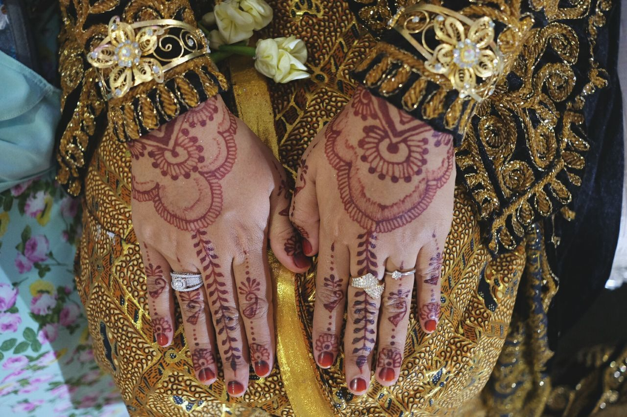 Traditional Indonesian Wedding Cultures Celebration Traditional Clothing Wedding Ceremony Tradition Wedding Human Hand Lifestyles Pattern Human Body Part Religion Women Bride Close-up Midsection Ceremony Two People Sari Adult People Hena Henatattoo Tattoo Paint Bodypaint