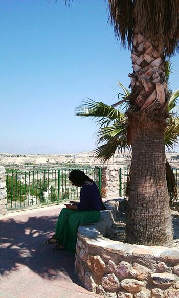 Under my palmtree One Young Woman Only Palm Tree Spain_beautiful_landscapes Spainphotographer Spain_vacations Spain ✈️🇪🇸 Alicante Province Spain Costa Blanca Holiday Sitting Outside Reading & Relaxing Shadows & Lights Love Yourself Tree Palm Tree Beach Adult Outdoors Day People Sky Nature One Person