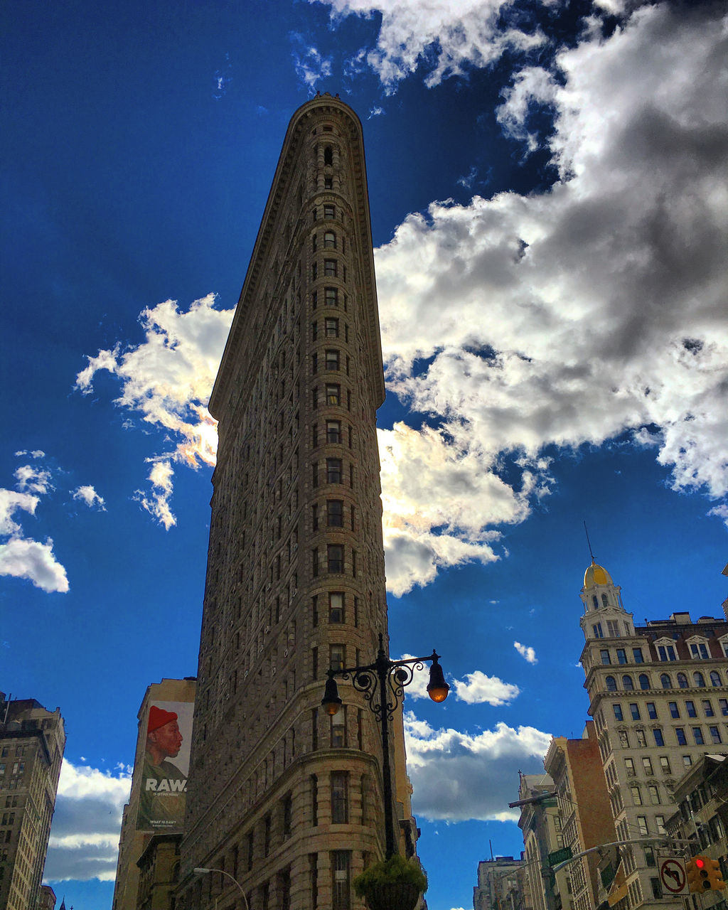 sky, architecture, low angle view, cloud - sky, building exterior, built structure, outdoors, day, city, blue, no people