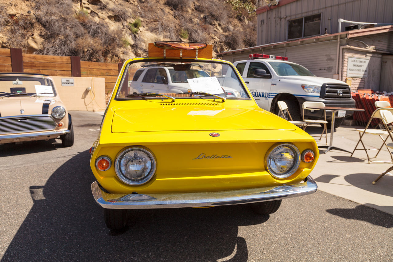 Laguna Beach, CA, USA - October 2, 2016: Yellow 1970 Fiat Schiller with wicker seats owned by Jim Roy and displayed at the Rotary Club of Laguna Beach 2016 Classic Car Show. Editorial use. 1970 Beach Beach Cruiser Car Show Classic Car Classic Car Show Day Fiat Schiller Laguna Beach Laguna Beach, CA Lemon Yellow Car No People Old Car Old Yellow Car Vintage Car Wicker Seats Yellow Car Yellow Fiat