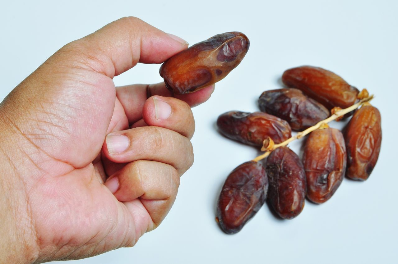 Kurma - Dates Palm Human Body Part Human Hand Food Close-up One Person Healthy Eating Food And Drink Studio Shot People Indoors  Freshness Kurma Ramadhan Dates Fruit Dates Palm Moslem Glucose Sweet Food Puasa Power Healthy Lifestyle Nature Fruit Fruits And Vegetables Palm Fruits