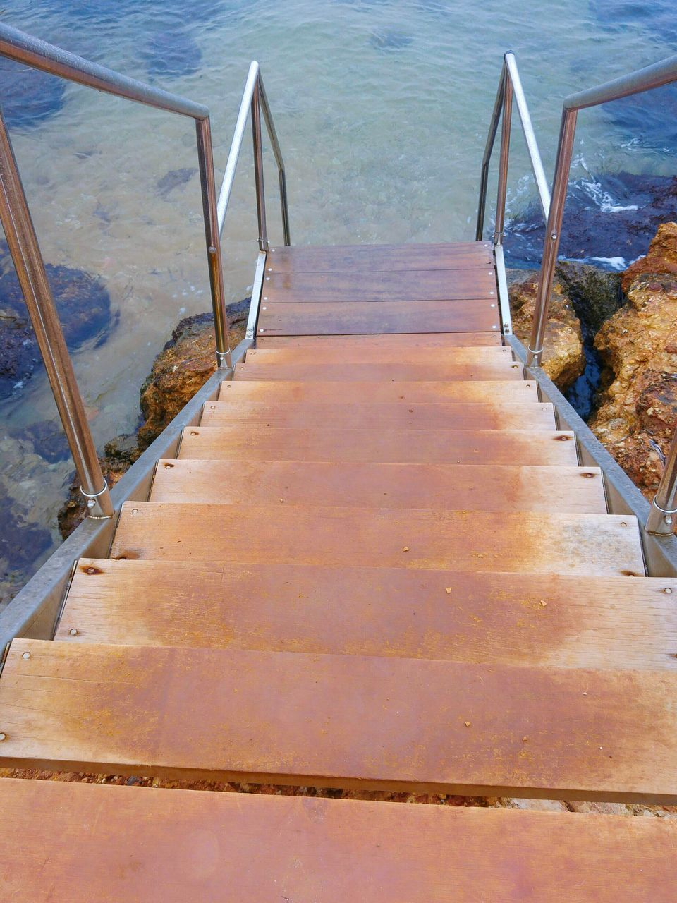 water, railing, sea, steps, the way forward, nature, staircase, steps and staircases, no people, day, tranquility, outdoors, beauty in nature, scenics, hand rail, horizon over water