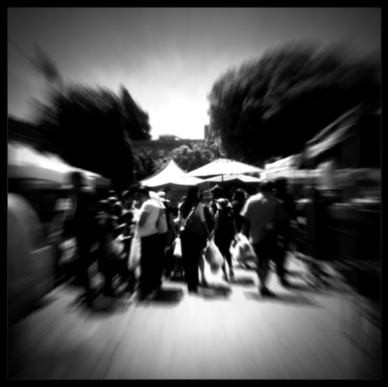 blurred motion, auto post production filter, motion, speed, transportation, road, men, real people, large group of people, day, women, outdoors, adult, people