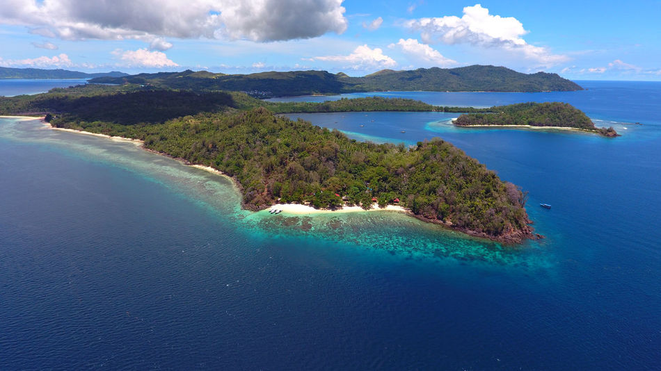 Bangka Island - Diving Destination Bangka Island Beach Beauty In Nature Bird's Eye View Blue Blue Sky Day Drone  Dronephotography EyeEm Best Shots EyeEm Nature Lover Island Landscape Landscape_Collection Manado - North Sulawesi, Indonesia. Mountain Nature Nature Reserve Outdoors Scenics Sky Travel Destinations Water F Islands lying High