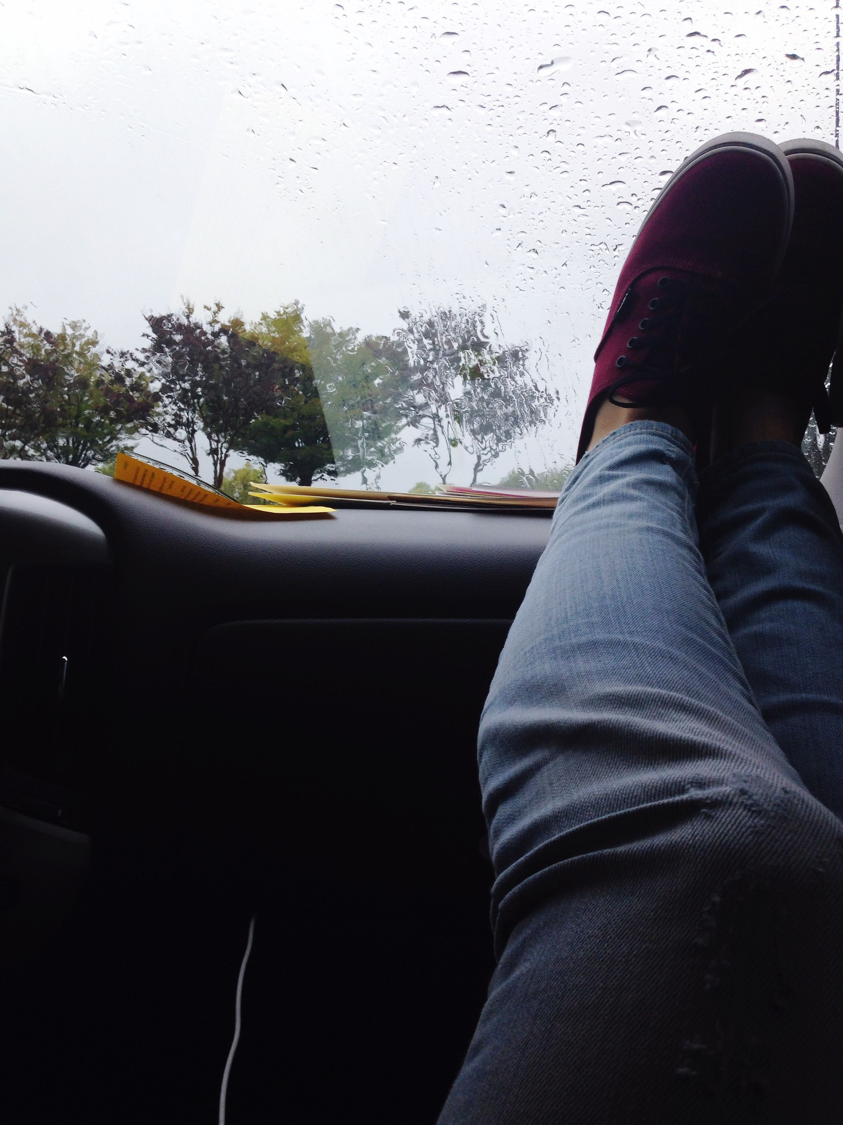 low section, person, personal perspective, shoe, transportation, car, land vehicle, mode of transport, part of, lifestyles, tree, men, street, human foot, vehicle interior, car interior, jeans