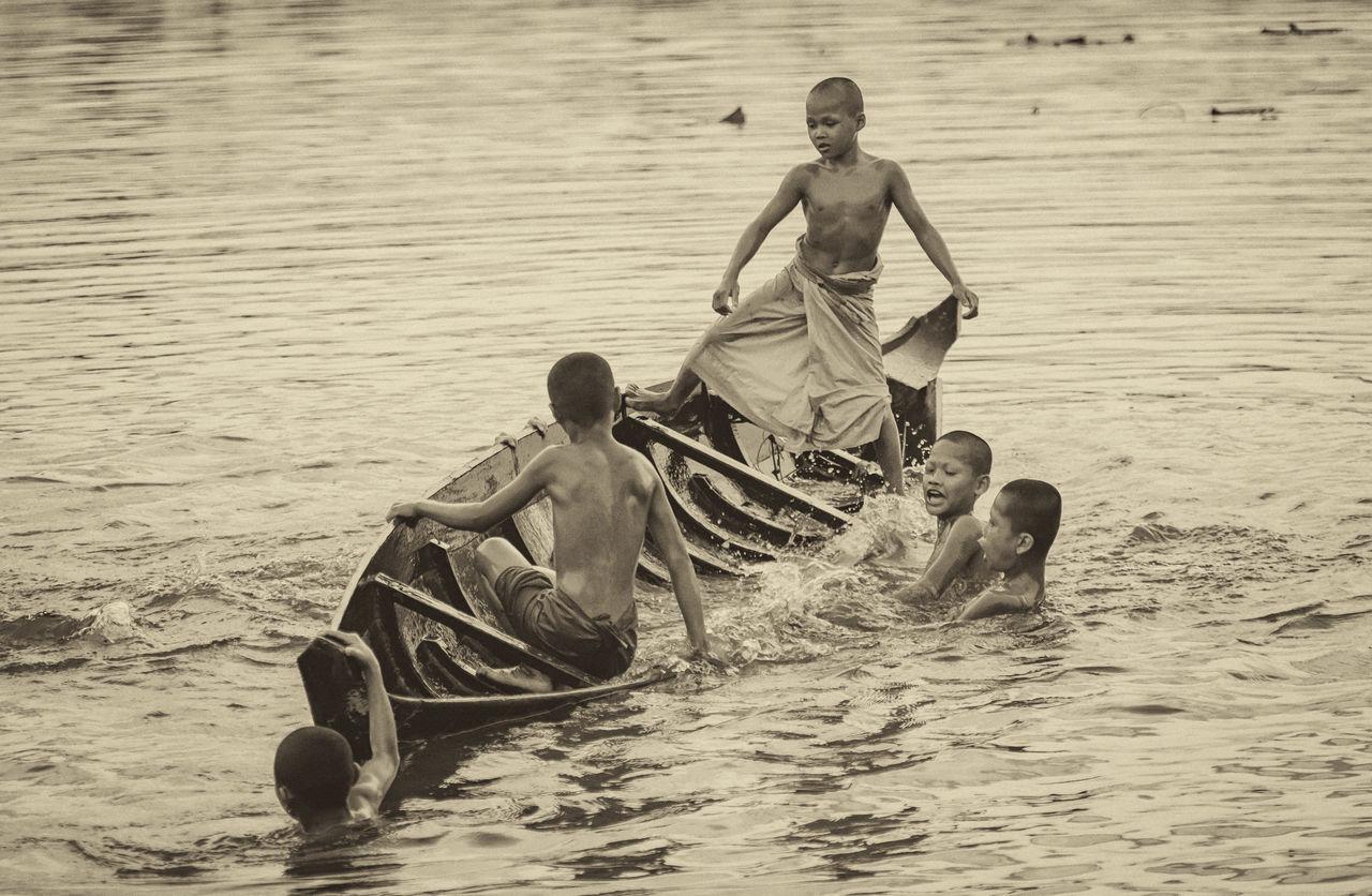 Don't rock the boat.... ASIA Balance Buddhism Buddhist Monks Cambodia Canoe Culture Havingfun Khmer Lake Monks Outdoors Playing Rocktheboat Sinking Water
