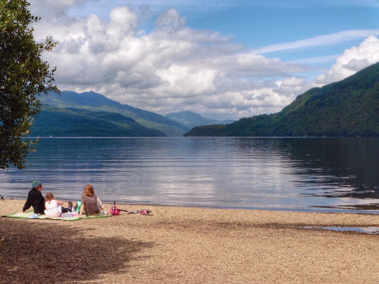 Mountain Two People Togetherness Beauty In Nature Sky Lake Nature Cloud - Sky Leisure Activity Real People Men Relaxation Bonding Lifestyles Women Tranquility Outdoors Water Idyllic Mountain Range Travel Photography Scotland LochLomond Picnic Rear View