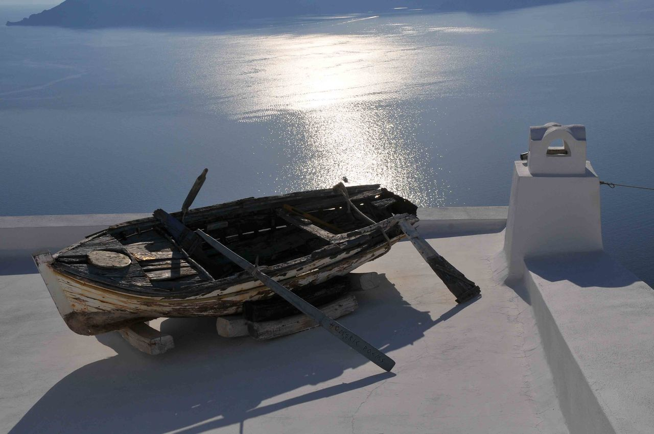 It has seen better days Boat Mode Of Transport Moored Old Boat Outrigger Santorini Island Sea Tranquil Scene Tranquility Water