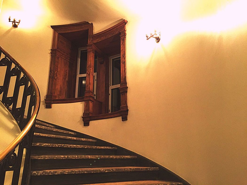 Stairway to the stars Architecture Built Structure No People Illuminated Soft Light Window Frame Staircase Evening Light Wooden Frame Wall Sconce Curved Stairs Deep Thoughts Lonely Window Ledge