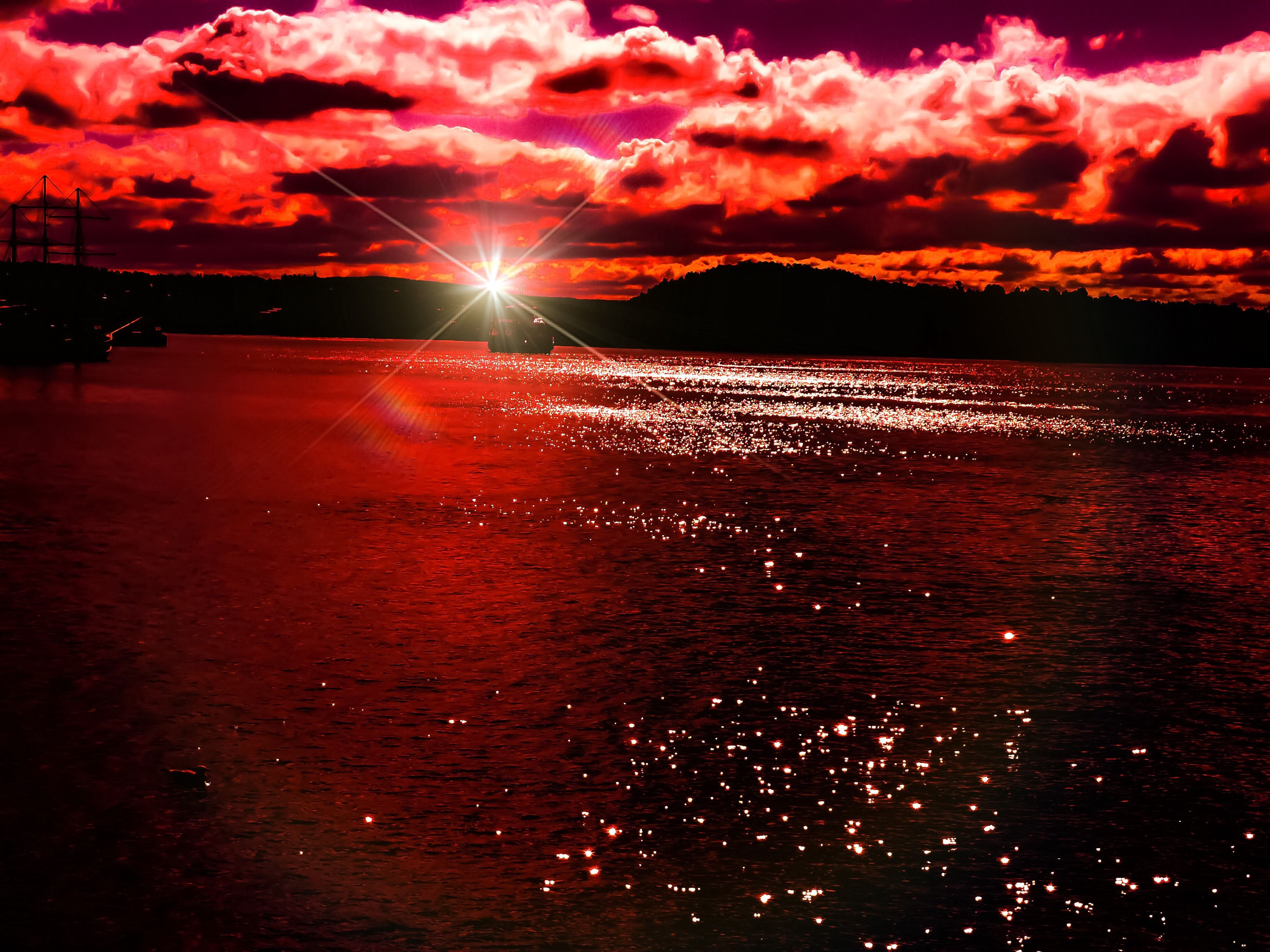 sunset, red, outdoors, no people, beauty in nature, water, dramatic sky, sky, nature, illuminated, shiny, sunbeam