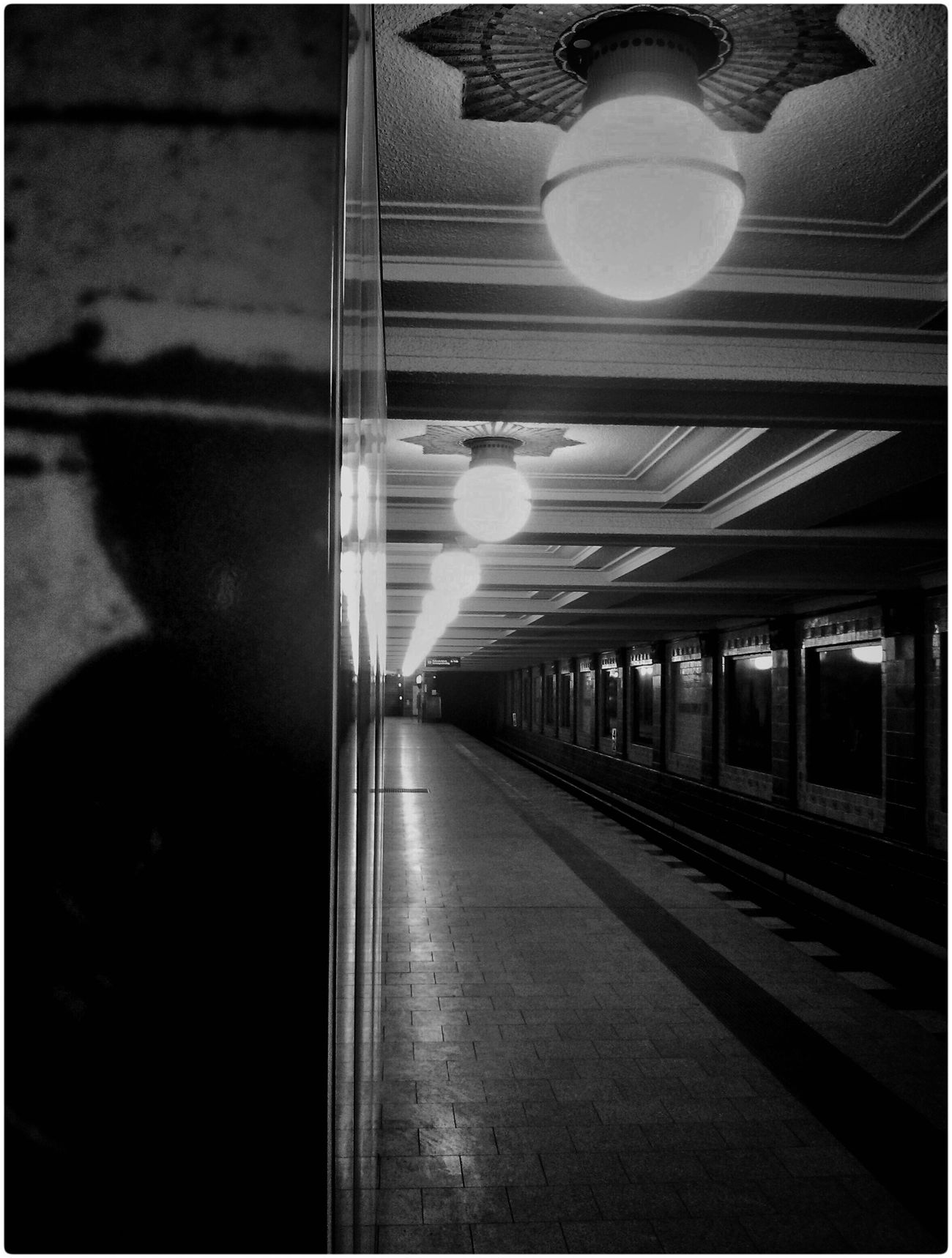 Tyranny is lurking around the corner. Black And White Perspective Tunnel Train Station Light At The End Of The Tunnel Figure Looming On The Way