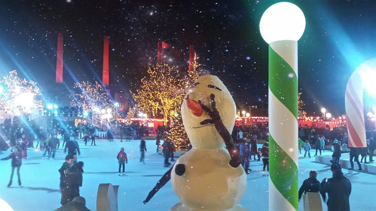 night, illuminated, large group of people, winter, arts culture and entertainment, cold temperature, leisure activity, real people, enjoyment, outdoors, snow, ice-skating, ice rink, crowd, ice skate, people