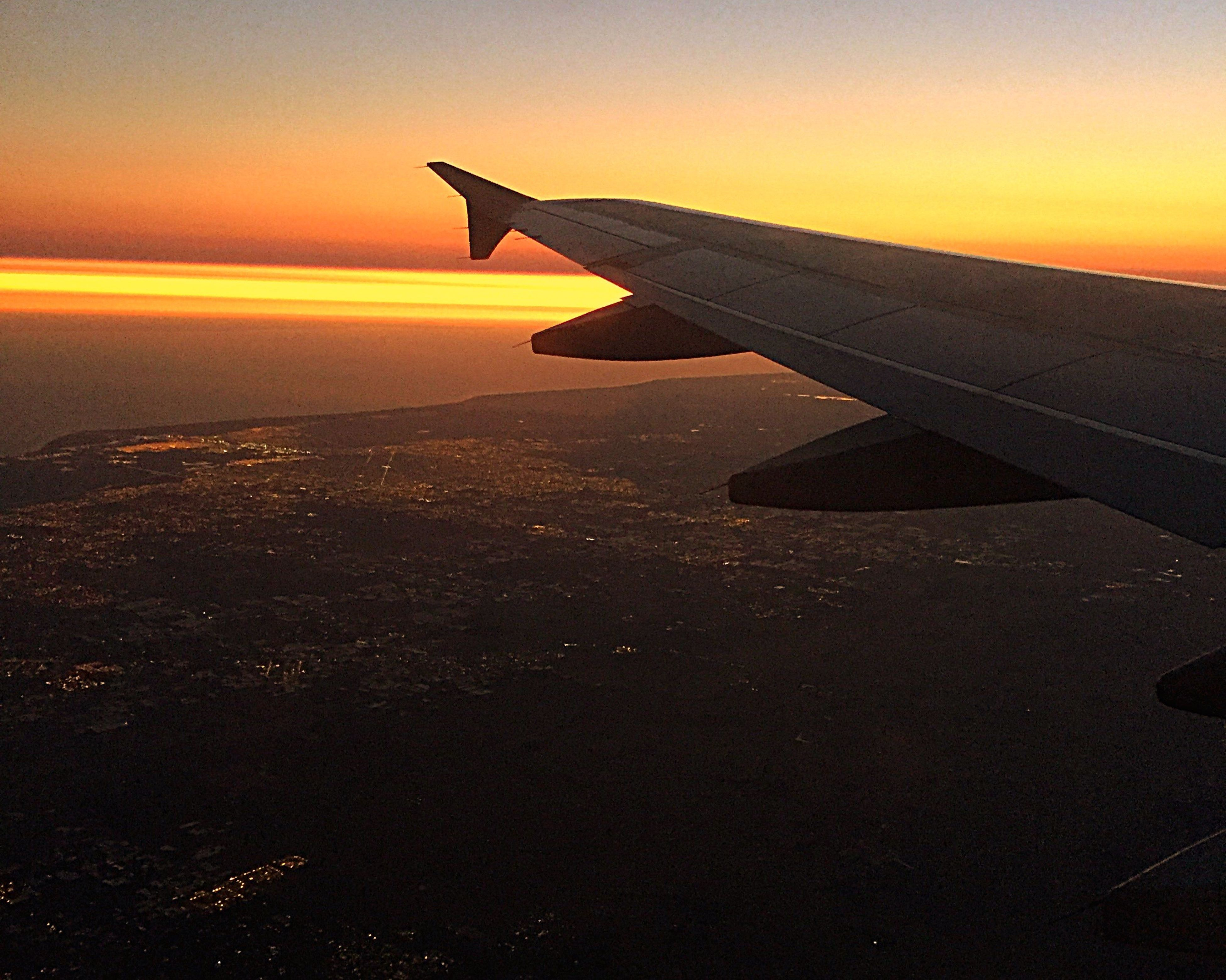 sunset, aircraft wing, airplane, nature, commercial airplane, aerial view, no people, scenics, sky, horizon over water, outdoors, water, air vehicle, cityscape, day