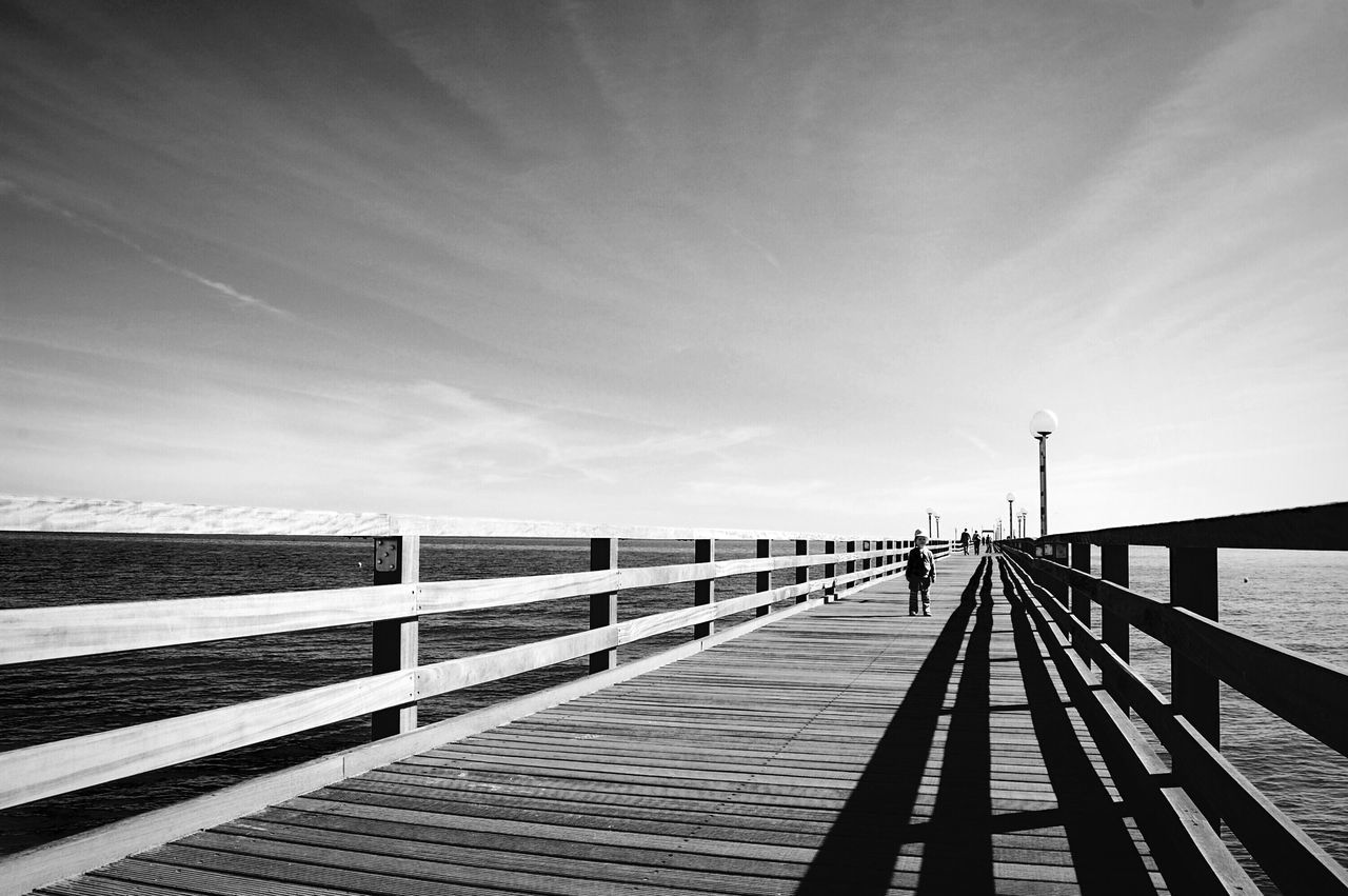 Bridge. Pier Sea Railing Wood - Material Water Baltic Sea Wood Paneling Sky Sky And Clouds Clouds And Sky Landscape Little Daughter Black And White Black & White Black And White Photography Blackandwhite Photography Binz Auf Rügen Seebrücke Scenics Sunlight Shadows & Lights Horizon Over Water Monochrome The Architect - 2017 EyeEm Awards The Great Outdoors - 2017 EyeEm Awards