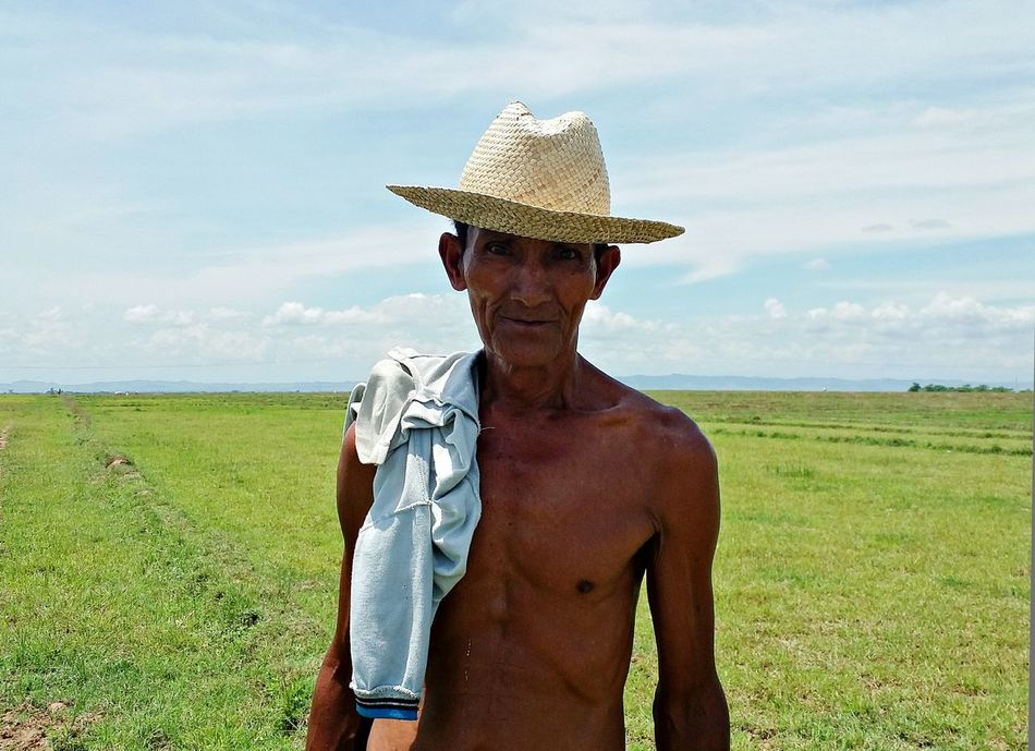 No pain, no gain.. Grass Casual Clothing Field Sky Person Sunlight Lifestyles Standing Non-urban Scene Tranquility Outdoors Green Color Nature Scenics Tranquil Scene Grassy Farmer Filipino EyeEm Eyeem Philippines EyeEm Portraits Portrait Brown Old Hard Worker