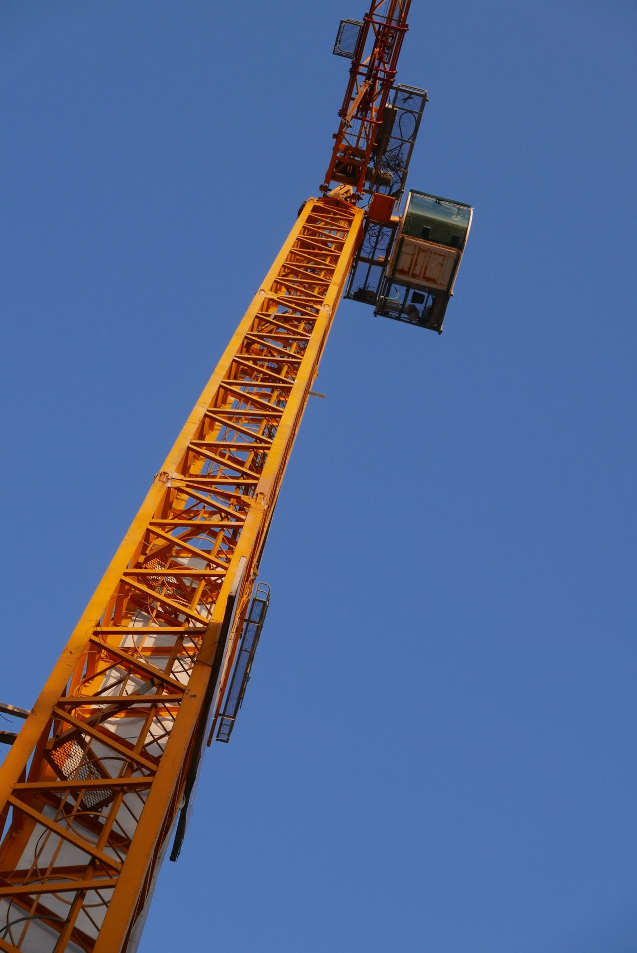 Construction crane against blue sky at dusk Crane Construction Construction Crane Blue Sky