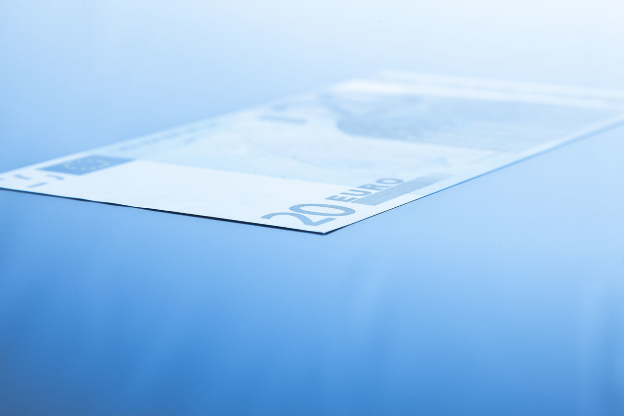 Twenty euro note on blue background Accounting Banking Blue Background Blue Tone Bonus Copy Space Financial Planning Financial Service Money Paper Money Premium Text Space Twenty Euro